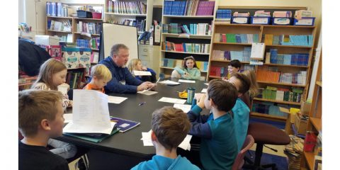 Medieval Scholar works with WES students